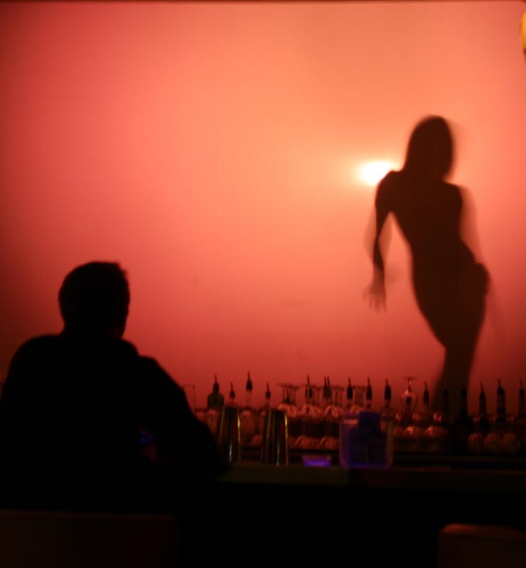 Shadow dancer in a Vegas bar