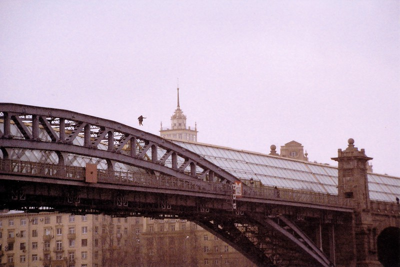 Person jumping on the top of a bridge. Moscow March 2014