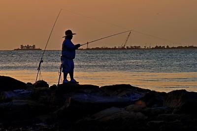 Single Fisherman Silhouette