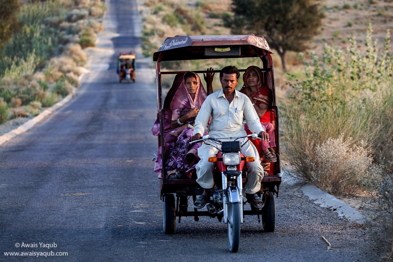 Women travel on Motorcycle Rickshaw in Mithi district of Sindh