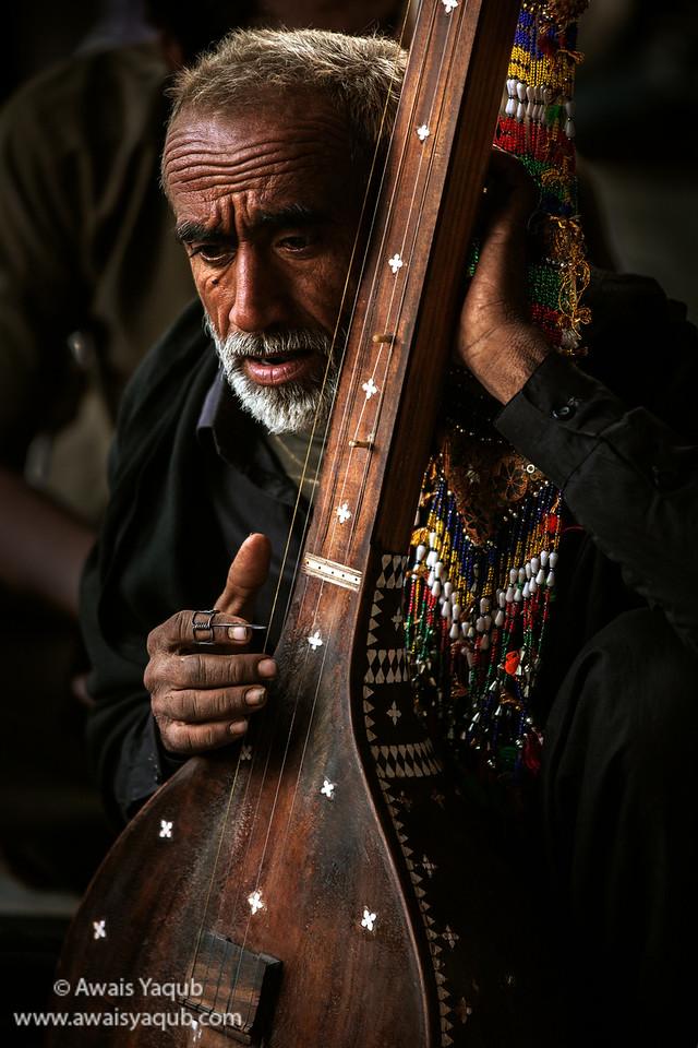 Devotee sings verses of poetry by Shah Abdul Latif Bhitai, Sufi saint buried in Bhitshah Sindh Buy Prints online