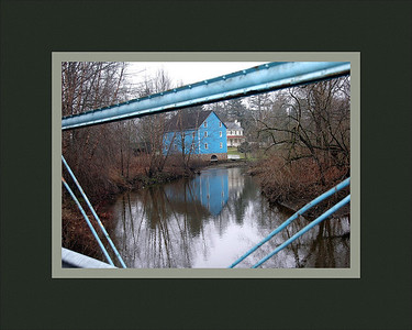 bridge near pauls      added caption  i spotted this and its a winner the blue bridge framing the blue building which i now know is the old gristmill.  good  job  skip