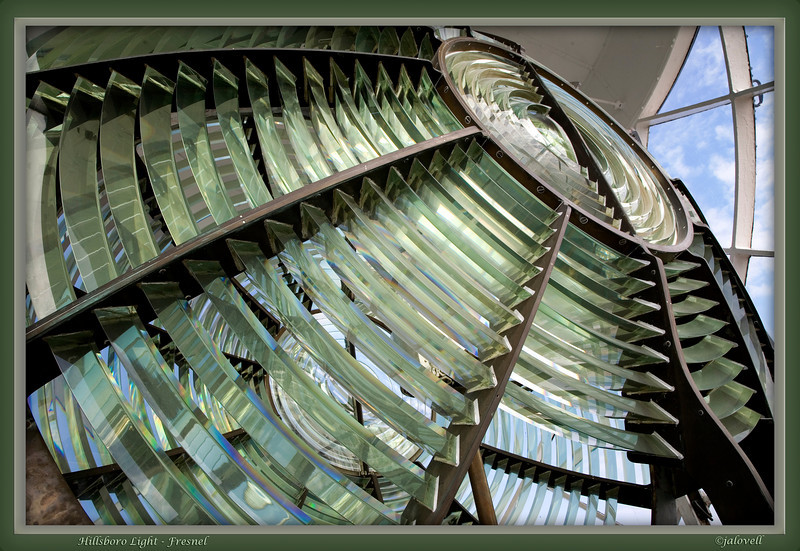 "The Hillsboro Lighthouse is fitted with an original Second Order bivalve Fresnel lens. Manufactured with the encryption: ""Phares & Fanaux, Barbier, Benard & Turenne, 82 Rue Curial, Paris"", the lens consists of concentric prisms arranged in panels around a central bullseye. The two halves resemble a bivalve shell.  A mercury float trough was once used but today a ball bearing system in oil supports the 2 and 1/2 ton lens. Known as  the ""big diamond' this light shines 28 nautical miles out to sea."