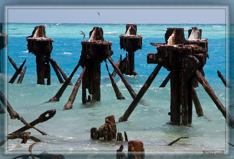 Coaling Dock Pilings-The old pilings make an interesting contrast with the brilliant blue waters off of Garden Key.
