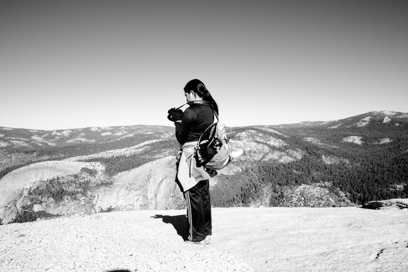 Taking pictures of Yosemite Valley from Half Dome.