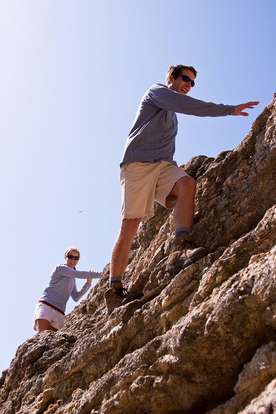 It's not dangerous walking on the edge of rock as long as you smile!