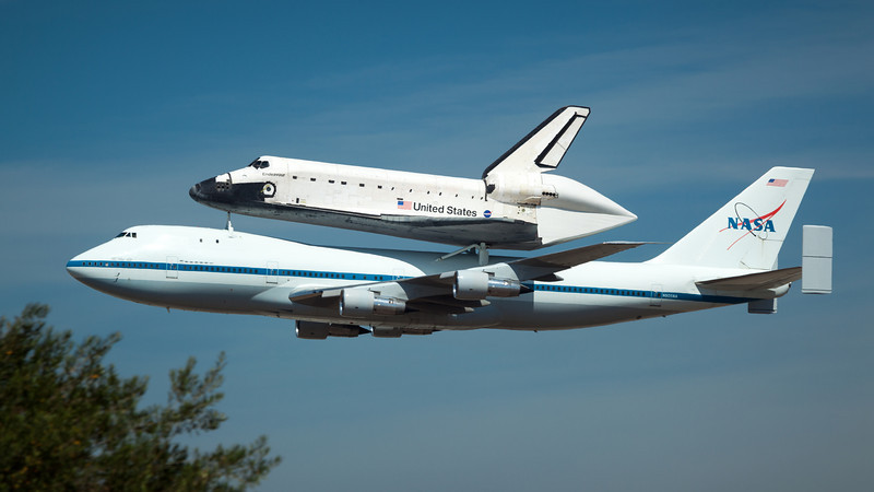 The shuttle's second pass is a lot lower and much closer to The Proud Bird.  If the 747's landing gear were down, I would think she is on final approach!