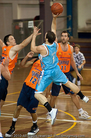 Adam Gibson elevates for the finish - Gold Coast Blaze v Cairns Taipans pre-season NBL basketball game, Saturday 18 September 2010, Carrara, Gold Coast, Australia.
