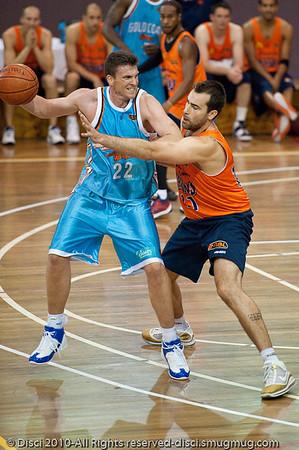 Stephen Hoare v Ian Crosswhite - Gold Coast Blaze v Cairns Taipans pre-season NBL basketball game, Saturday 18 September 2010, Carrara, Gold Coast, Australia.
