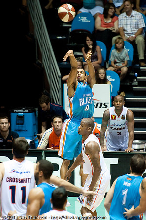 "Darry Hudson shows nice shooting form - Gold Coast Blaze v Cairns Taipans NBL Basketball, Wednesday 19 January 2011; Gold Coast Convention & Exhibition Centre, Broadbeach, Queensland, Australia. Photos by Des Thureson:  <a href=""http://disci.smugmug.com"">http://disci.smugmug.com</a>"
