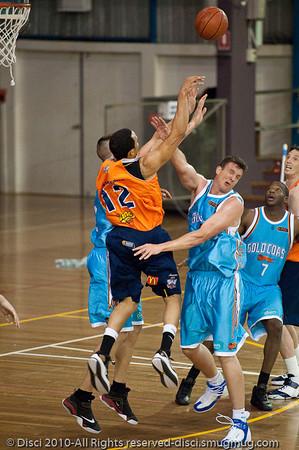 Stephen Hoare v Daniel Dillon - Gold Coast Blaze v Cairns Taipans pre-season NBL basketball game, Saturday 18 September 2010, Carrara, Gold Coast, Australia.