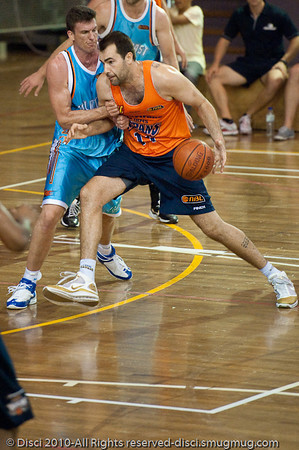 Ian Crosswhite & Stephen Hoare continue their battle - Gold Coast Blaze v Cairns Taipans pre-season NBL basketball game, Saturday 18 September 2010, Carrara, Gold Coast, Australia.