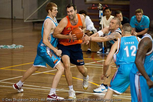 Crosswhite v Garlepp - Gold Coast Blaze v Cairns Taipans pre-season NBL basketball game, Saturday 18 September 2010, Carrara, Gold Coast, Australia.