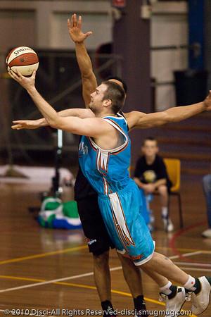 Brand new Blaze player Mark Worthington goes inside against former Blaze player Mika Vukona - Gold Coast Blaze v New Zealand Breakers NBL basketball pre-season game; 4 October 2010, Carrara Stadium, Gold Coast, Queensland, Australia