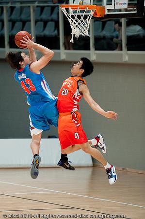 Chris Goulding drives aggressively inside - Pre-Season NBL International Basketball: Gold Coast Blaze v Anyang KT & G Kites - Korea; Logan City, Queensland, Australia; 2010.