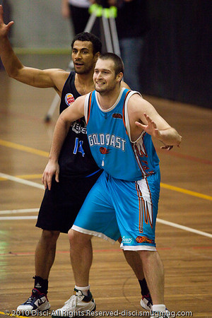 Mark Worthington shows his usual affable manner as he posts Mika Vukona - Gold Coast Blaze v New Zealand Breakers NBL basketball pre-season game; 4 October 2010, Carrara Stadium, Gold Coast, Queensland, Australia