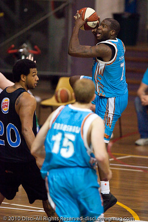 James Maye elevates with an eye for the hoop - Gold Coast Blaze v New Zealand Breakers NBL basketball pre-season game; 4 October 2010, Carrara Stadium, Gold Coast, Queensland, Australia