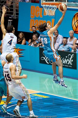 "Chris Goulding with the brilliantly agile drive inside, to beat Lindsay Tait - Gold Coast Blaze v Cairns Taipans NBL Basketball, Wednesday 19 January 2011; Gold Coast Convention & Exhibition Centre, Broadbeach, Queensland, Australia. Photos by Des Thureson:  <a href=""http://disci.smugmug.com"">http://disci.smugmug.com</a>"