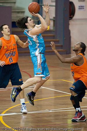 Chris Goulding returns the favour to Deba George - Gold Coast Blaze v Cairns Taipans pre-season NBL basketball game, Saturday 18 September 2010, Carrara, Gold Coast, Australia.