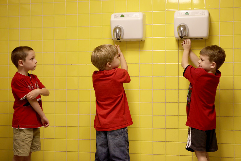 By Alex Turco/Journal & Courier-- Kindergartners Joey Bucklin (left) and Max Scanlon dry their hands after washing them for lunch, while Fletcher Mitten waits his turn at Klondike Elementary School, Tuesday, August 18, 2009.