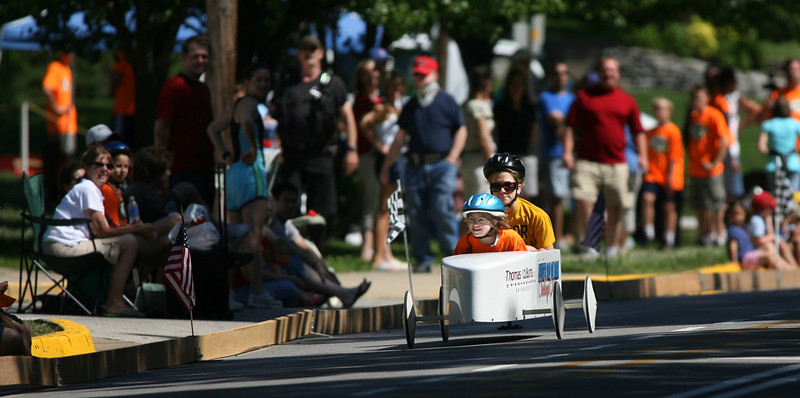 By Alex Turco/Journal & Courier-- A challenge rider and helper race down Grant Street Hill in front of West Lafayette High School as part of the annual Lafayette Soap Box Derby, held Saturday, June 20, 2009 in West Lafayette.