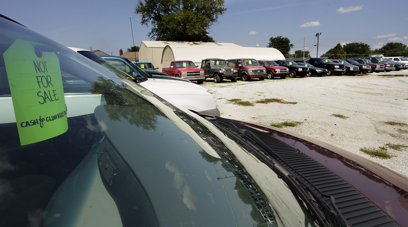 By Alex Turco/Journal & Courier-- Cars disabled as part of the Cash for Clunkers program sit in a lot behind the former Mall Motors in Lafayette, on Wednesday, August 5, 2009.