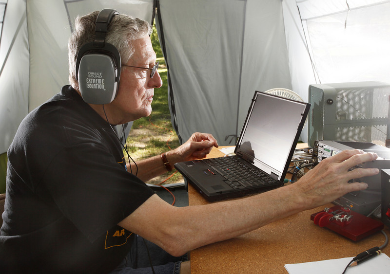 "By Alex Turco/Journal & Courier-- Tom Kuespert operates a Morse code transmitter from his tent in Murdock Park on Sunday, June 28, 2009. The Tippecanoe Amateur Radio Association participated in the Emergency Communications Exercise over the weekend of June 27-28, 2009. The Emergency Communications Exercise, organized by the Amateur Radio Relay League, simulates the kind of communication that would be needed in a crisis situation where normal means of communication were disabled. TARA set up a variety of transmitters in Murdock Park, including gear to transmit and receive both voice and morse code signals.  The exercise is a contest, in which TARA members competed with radio enthusiasts around the country to make as many contacts as possible with other users. <br /> <br /> While the contest is mostly a fun exercise, the ability to communicate using alternative means is a valuable asset in a disaster. Greg Dean, TARA's vice-president, said that radio operators were ""able to communicate in the middle of a hurricane."" The group chose Murdock Park as their location because of its proximity to Murdock Elementary and the Red Cross, prime sites for an emergency shelter. In the event of an emergency, radio operators may be called upon to transmit information from such a shelter after other lines of communication are down."