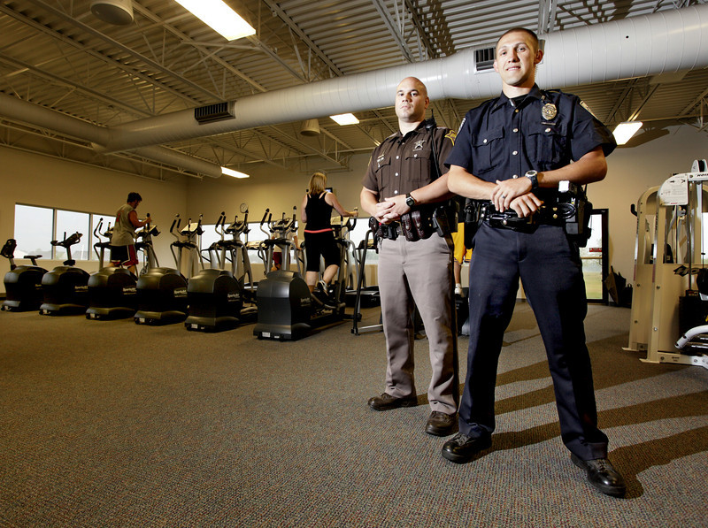 By Alex Turco/Journal & Courier-- Benton County sheriff's deputy  Jason Dexter (left), who will be competing in weightlifting, and Lafayette police officer Jacob Daubenmier, who will be competing in track events, will be traveling to the World Police and Fire Games in British Columbia, Canada, next week. They are pictured in the workout room at Faith Baptist Community Church on July 28, 2009.