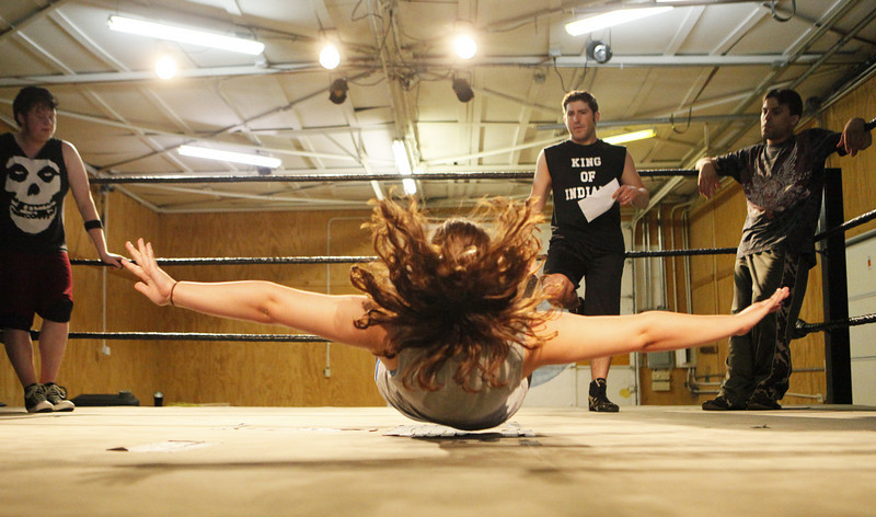 By Alex Turco/Journal & Courier-- Joanna Spradlin practices a move at Billy Logsdon's wrestling school, Saturday, June 20, 2009 in Lafayette.