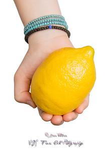Hands Offering a Lemon