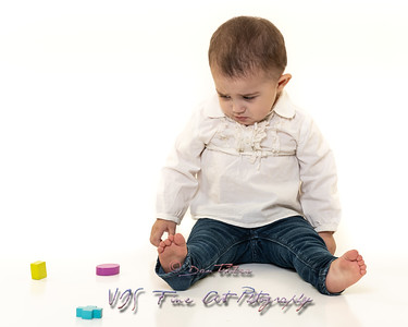 Toddler with Wooden Shape Toys