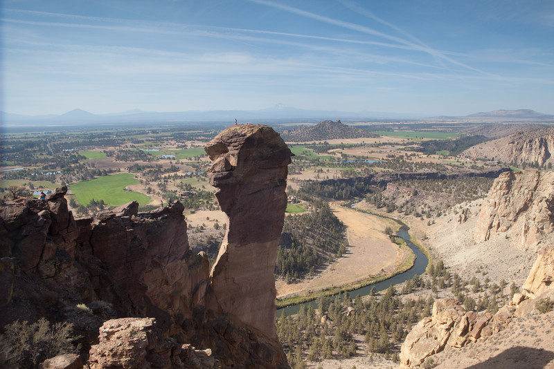 The view from the top of Smith Rock State Park looks over Monkey Face, down the Crooked River to Three Fingered Jack and Mount Jefferson.