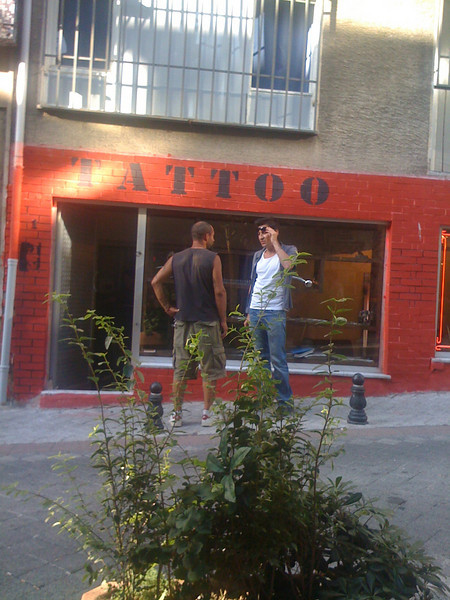 While sitting in the HERA cafe (Kadikoy, Istanbul) with my friend Volkan Olgun, I took the picture of the opposite tatoo shop.<br /> (Photo taken with my iPhone 3G, and SmugShot automatically sent it to this page!!)