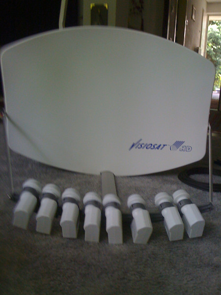 My multifocal satellite dish with EIGHT Quad lnb's, in the process of getting wired (it takes 32 cables for the LNB's alone!!). It is connected to 4 x SPAUN SUR-211F and 8 x SPAUN SAR-411F DiSEqC switches, so that 4 satellite receivers can receive any of the 8 satellites, independently.<br /> (Photo taken with my iPhone 3G, and SmugShot automatically sent it to this page!!)