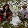 isabella and alexander make their first snowman. his name is lumpy!