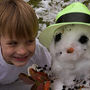 zan cheeses it up with the snowman