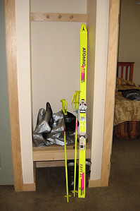 My skis stand by near the door of our bedroom unused since I am using the weekend to learn how to snowboard.  Though I've only used these skis on one previous trip (to Big Bear), Jason tells me that these bright yellow and flourescent pink-bottomed wonders belong in a museum.  I do not disagree...mom gave me this pair in the early 1990's!