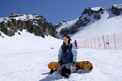I wanted to take Valerie around the back of Face Lift, down St Anton, and across to the backside runs of Chair 13 and 14...but someone had put a downhill race course in our way (the starting line was actually atop the Cornice).  With the temperature approaching 60 degrees, Valerie and I felt seriously overdressed (and we were just wearing thermals under our shells)