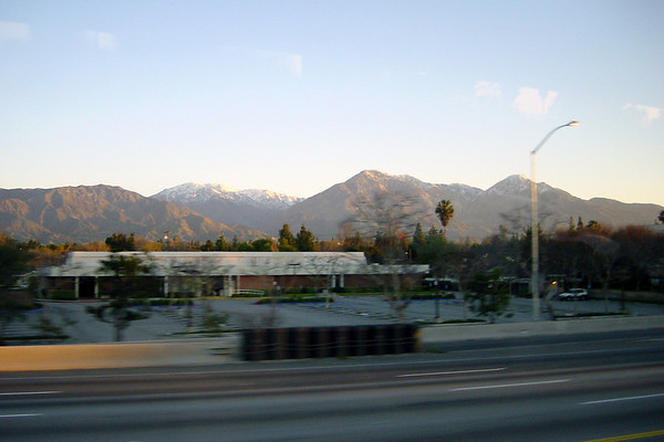 The sun rises over the San Gabriel Mountains (as seen across Interstate 10)