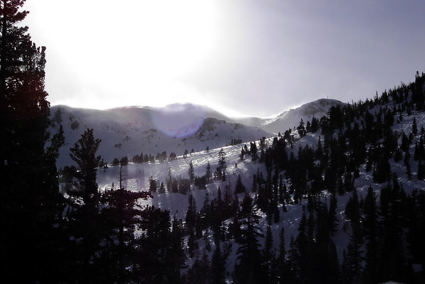 Late in the day, we split up so I can squeeze in a couple of powder runs before the lifts stop operating. As I look into the sun, I see snow blowing off over the top of Mammoth...must be getting windy up there