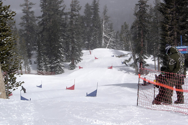 After watching the thrilling debut of snowboard cross at this year's Winter Olympics, Pete and I discovered that Mammoth actually has a boardercross course. Today, we successfully locate it and are able to enjoy a run before it is closed for competition. We vow to return later in the day...