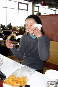 Val uses her cocoa to warm her face while enjoying her lunch