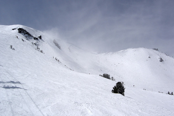 The top is open, but it is way too windy. Some people brave up to 60mph gusts to get the incredible powder, but not us