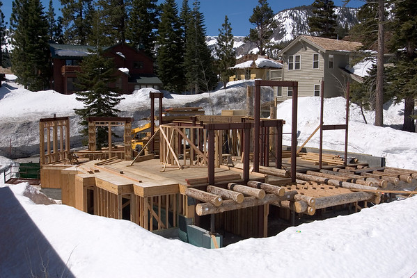 With no new snow, construction has progressed on their neighbor's house