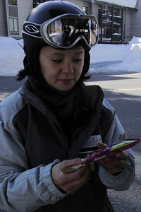 Valerie distributes the energy bars before we walk to the slopes