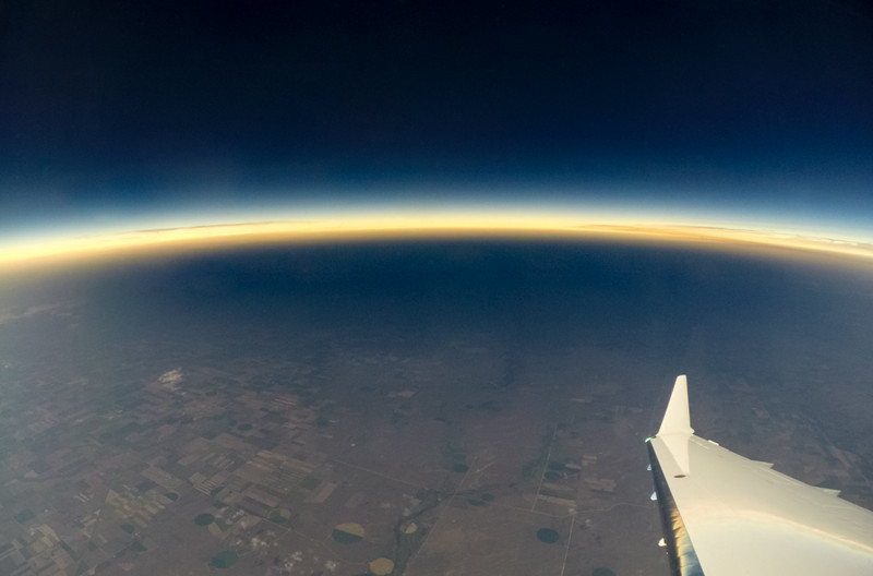 Solar eclipse shadow to our southwest as we turn to the south to fly through it.
