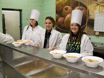 "(Panetta) Bethesda Project, ""My Brothers Place""  Cabrini students (Sarah, Ashley & Marcelle) serve a meal after spending time with the men at the shelter."
