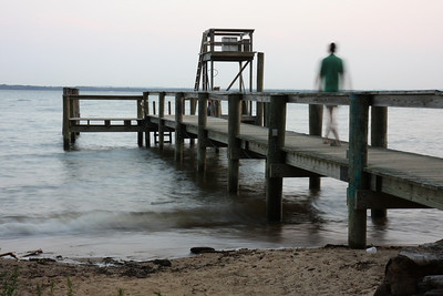 I took this at our Church retreat...the ghostly figure on the pier captured the contemplative moment.