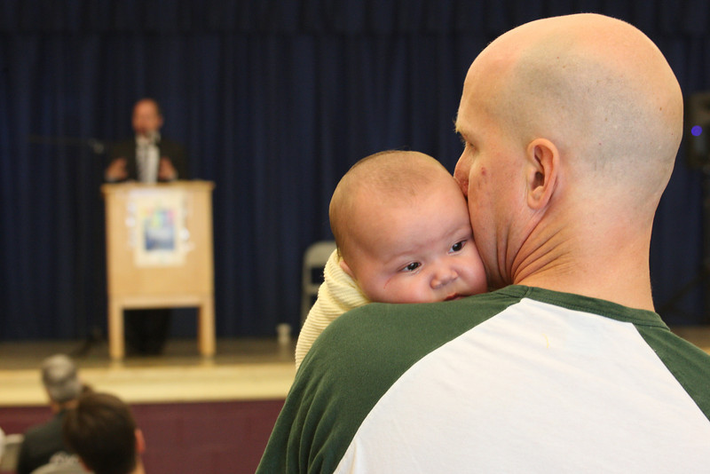 This was at a conference for LGBT parents. This dad cradles his baby with total affection while a transgendered lawyer is talking about legal efforts to make families like his against the law. There's a lot going on here!