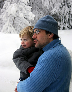 My older son and I in the snow when we lived in VT. I like our colors against the almost black and white background. It looks like a Photoshop trick, but it was the real setting.
